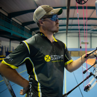 Archery top, shirt shooter jersey being worn by compound archer during competition