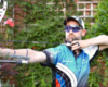 male recurve archer wearing x sight archery shooting glasses at full draw with his bow