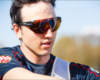 Team Gb archer Tom Hall pulling arrows from a target in the reflection of the brown lens of his X Sight archery glasses